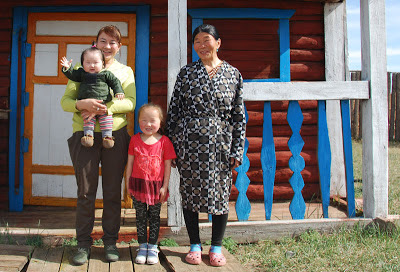 Naranzul (centre) with her family outside their home in Arbulag soum