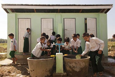 Children wash their hands with soap outside a latrine block at Katauk Sat Basic Education Primary School, Myanmar