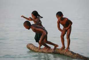 Children leap into a lagoon in Tarawa, the capital.