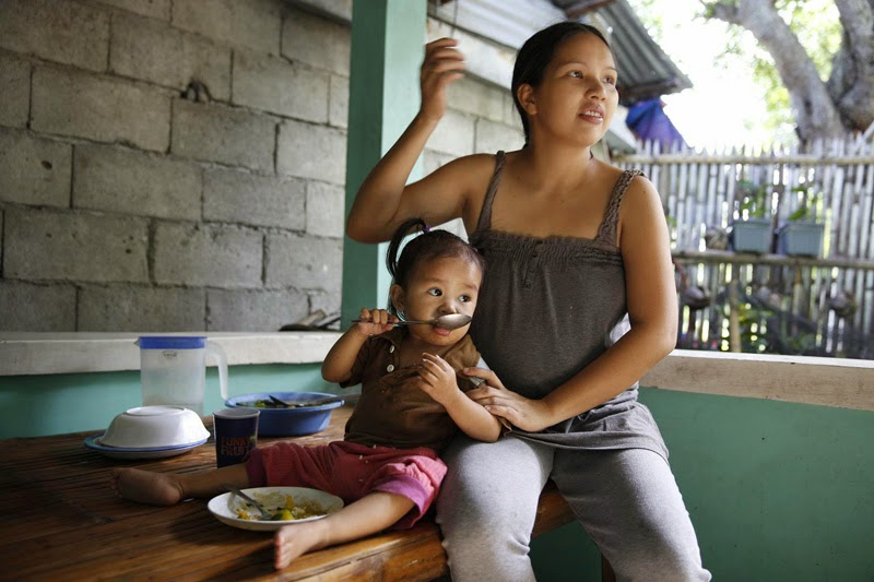 In the Philippines, Efrin has 2 children and is 7 months pregnant with a third