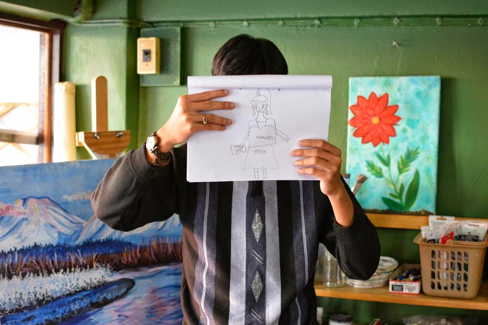 Saeng holds a picture