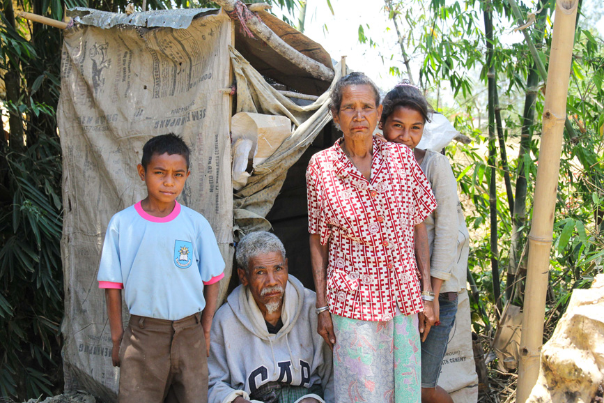 Christorio   together with his family outside his recently build toilet. Despite being unable to use his legs, he was determined to build the latrine and keep his family safe from disease.