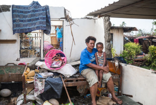 Photos: Families pick up the pieces after Cyclone Winston
