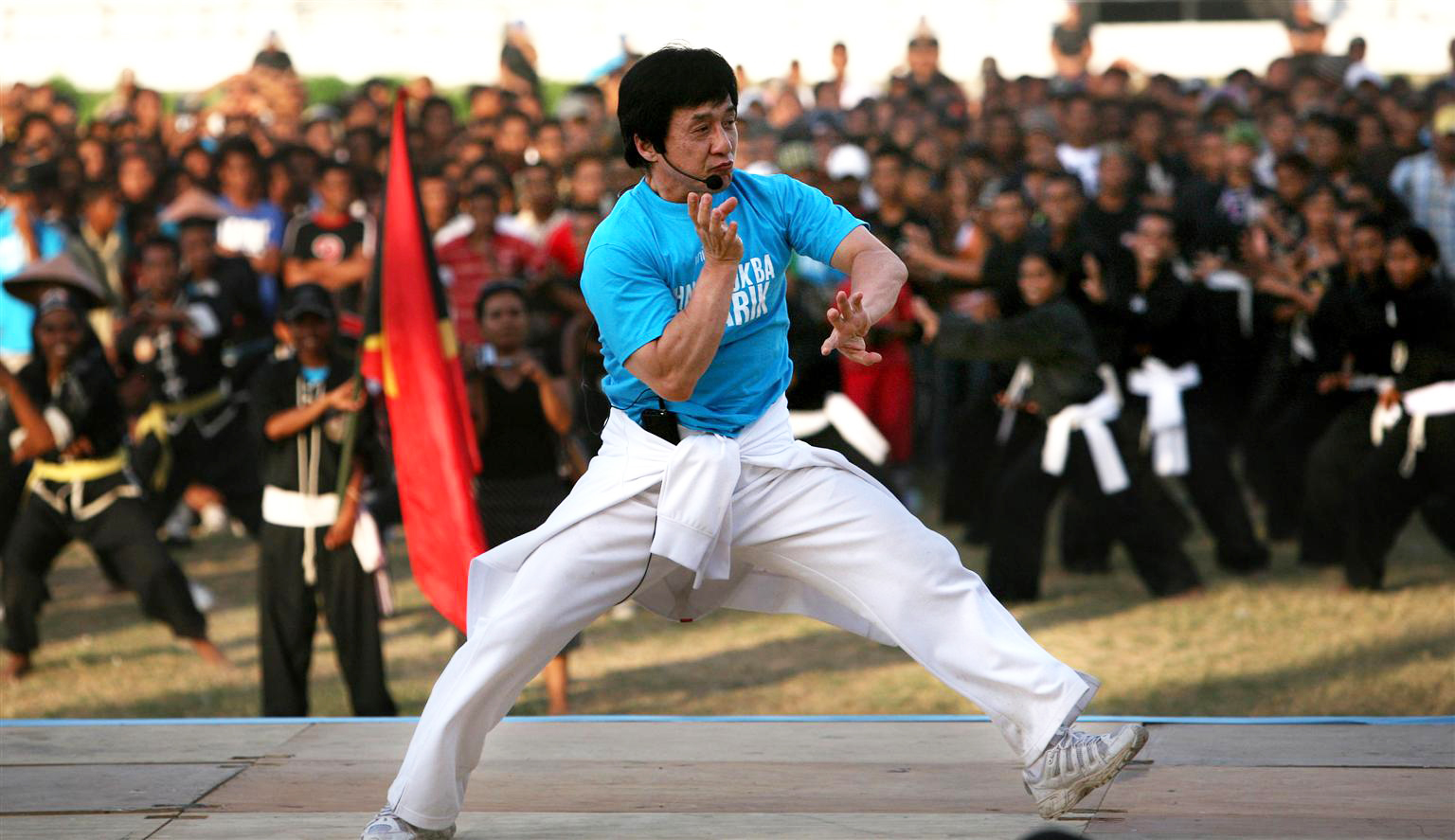 On 24 June, UNICEF Goodwill Ambassador Jackie Chan leads several hundred martial arts students in a martial arts exercise, at the national stadium in Dili, the capital. He wears a T-shirt that bears the UNICEF logo.