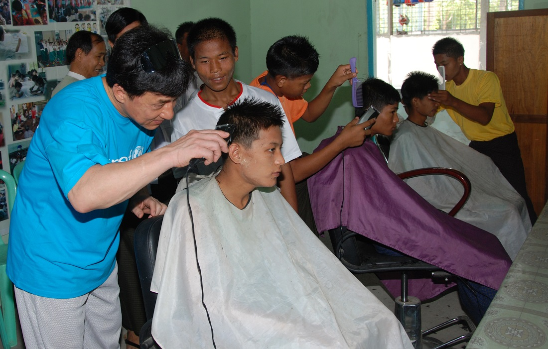 UNICEF Goodwill Ambassador Jackie Chan tries his skills as a hair dresser in a boys' training school in Myanmar. Using his celebrity status as a vehicle for humanitarian and public service work, Mr. Jackie Chan has been a UNICEF Goodwill Ambassador since 2004. During his UNICEF missions to Cambodia, Hong Kong, Japan, China and Timor-Leste he made numerous public service announcements to raise awareness on issues such as stigma and discrimination of children affected by HIV/AIDS, the legacy of landmines and the importance of creating a protective and peaceful environment for children. His UNICEF Goodwill Ambassador's work is in line with the mission of his foundation, 'The Jackie Chan Charitable Foundation', which focuses on the development of young people; teenagers in need and those who have suffered hardship and includes various youth development programmes. Jackie Chan helped raise awareness about child trafficking in Myanmar.