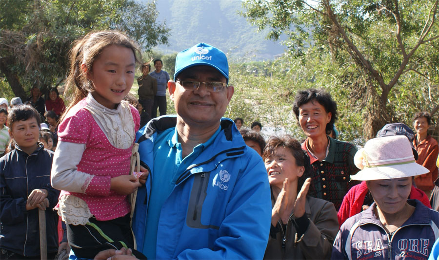 Kim, left, with UNICEF's Anil. She can't wait to go home and back to kindergarten.