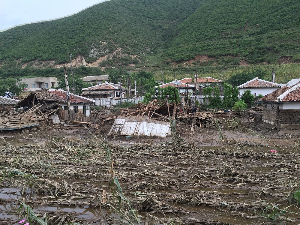 A village partially washed away by floodwaters on the road from Pyongyang to Musan county, North Hamgyong province, DPR Korea