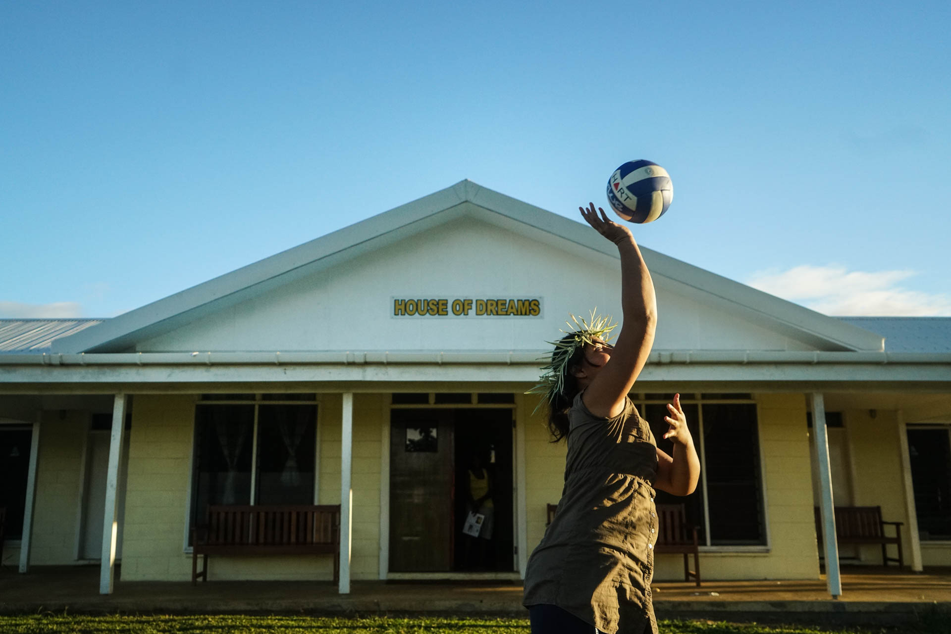 A girls plays outside The House of Dreams, the living quarters at the Campus of Hope shelter