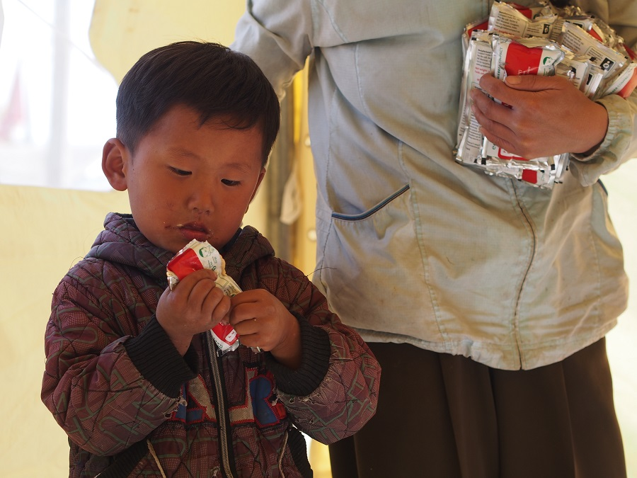A young boy receives Plumpynut, a nutrition supplement supplied by UNICEF.