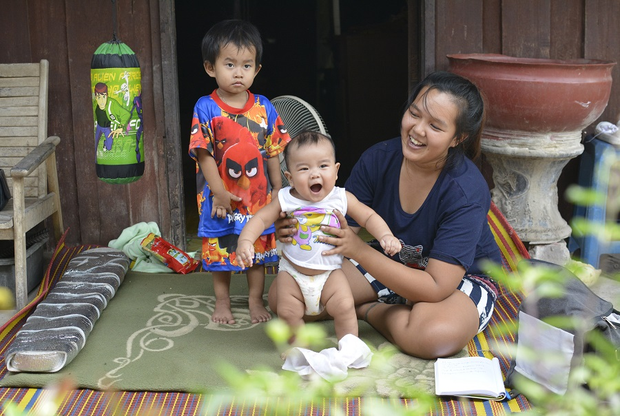 Narinthip Pommarin with her children Ang Bao, 5 months, and Ang Ban in Samut Songkran province. The family receives the Child Support Grant to help them with expenses for Ang Bao