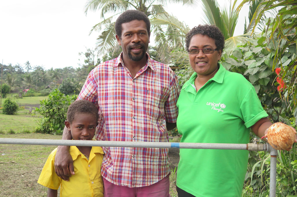 Marcel (centre), Head Teacher of Kings Cross Primary School in Tanna, talked to Christina, UNICEF Education Officer, about the benefits to his school of the training on emotional support and disaster risk reduction.