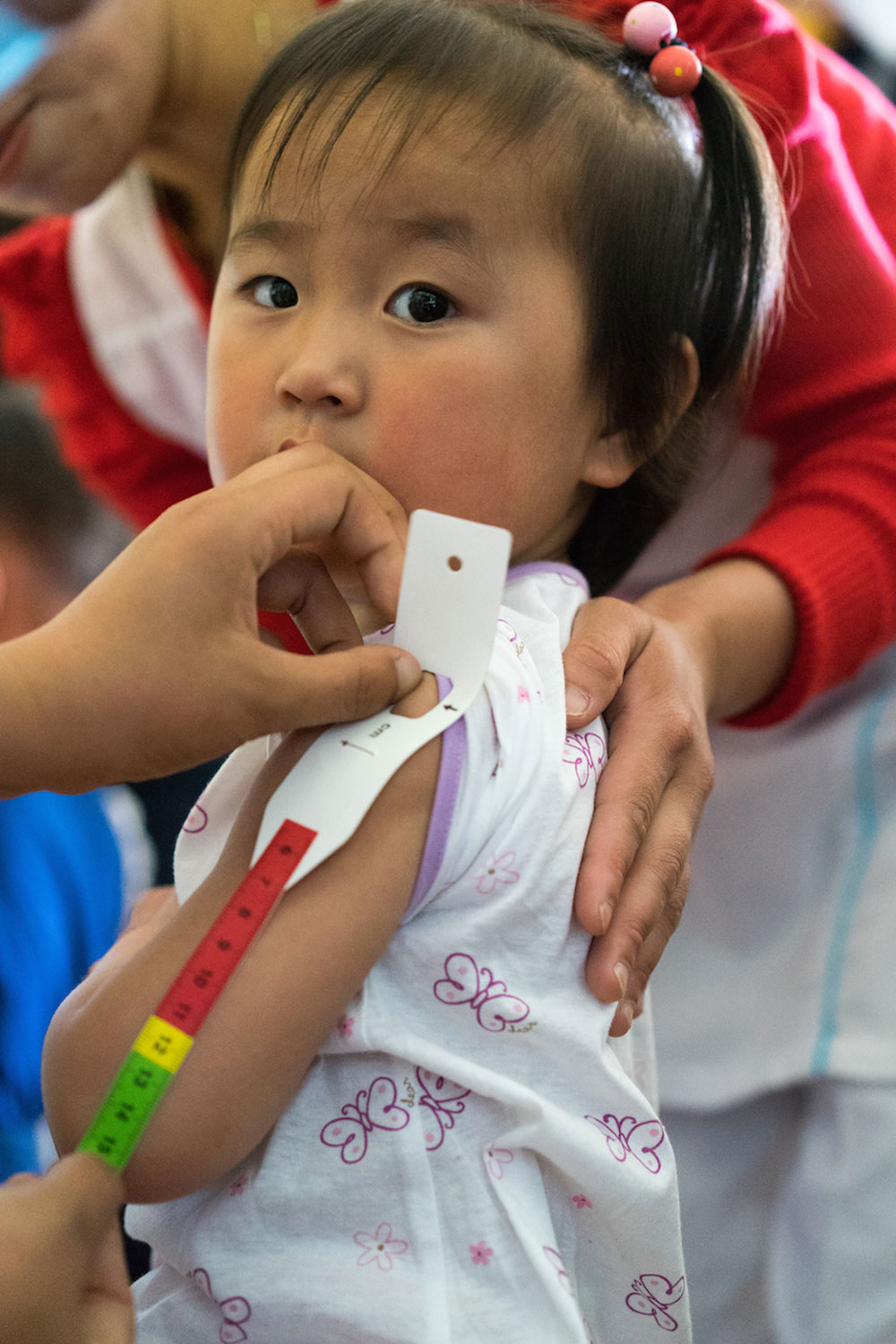 A girl is screened to identify her nutritional status and see if she needs to be referred for additional assistance