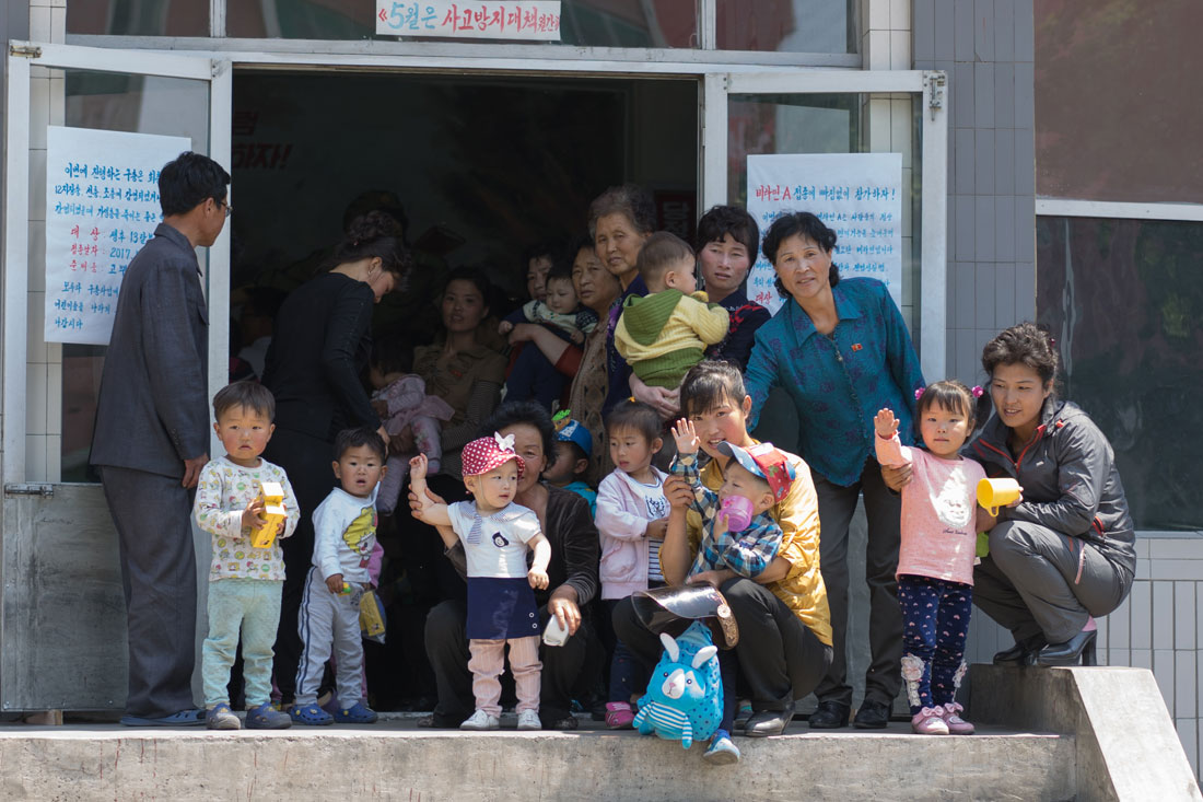 Mothers and children outside the district hospital in Sariwon City