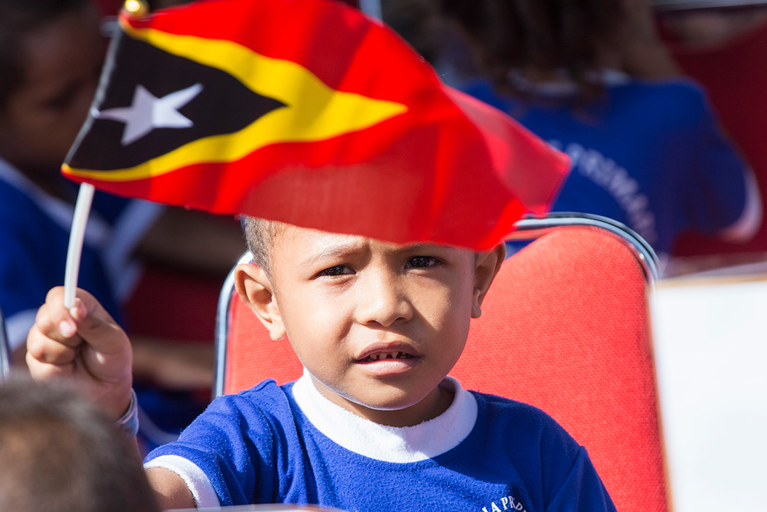 """""""One for all, All for one,"""" a young participant waving the national flag and chanting the slogan with the Prime Minister of Timor-Leste."""