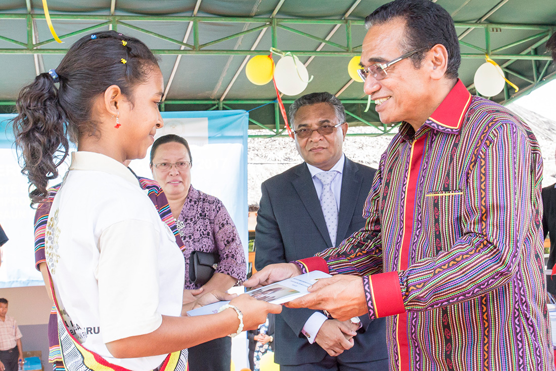 Francisco Guterres, President of Timor-Leste handing over the National Action Plan to Arsenia, a grade 7 student in the presence of the Prime Minister and others.