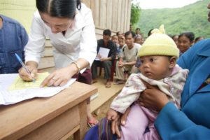 A district health team in Lao PDR updates a mother baby health record book.