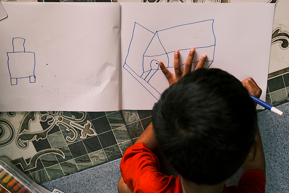 Children draw with items from a recreational kit for children affected by COVID-19 in Jombang, Indonesia, on 22 October 2020.
