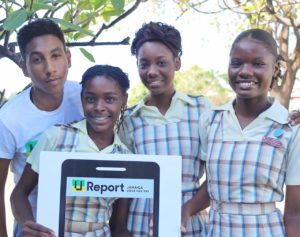 Photograph of Christopher Harper meeting students at Camperdown High School in Kingston during a series of school tours by Talk Up Yout/UNICEF to support the launch of U-Report in Jamaica on May 22, 2017.