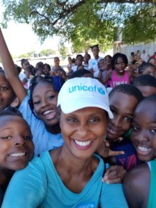 Photograph of UNICEF Jamaica staff member Audrey Tulloch playing with Half Way Tree Primary School students on Play Day 2018 held on Tuesday, November 20, World Children's Day.