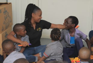 Photograph of Emprezz Golding making new friends during the 'Month of Play', held by her organisation Talk Up Yout during the month of November.
