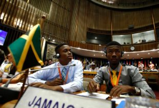Photo of Cameron Campbell representing the Peace Management Initiative (PMI), and Tavoy Miller, Fight for Peace attending the First Regional Dialogue of Latin America and the Caribbean 'On the Road to Equality': 30 years of the Convention on the Rights of the Child, held in Santiago Chile, November 27-29, 2018.