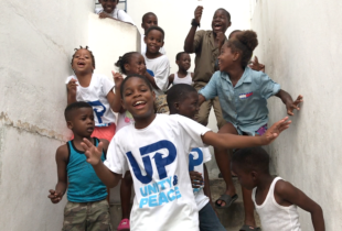 Photograph of Children having fun and learning at the same time with Edusport by Fight for Peace in Parade Gardens, Kingston.
