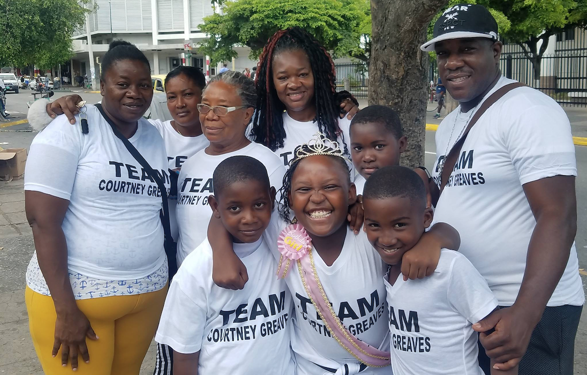 Photograph of Team Courtney Greaves helping others on the streets of Kingston.