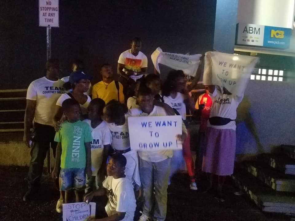Photograph of Members of Team Courtney, children and parents, protesting violence against children in Half-Way-Tree, St Andrew.