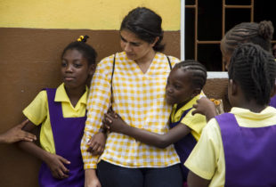 Photograph of Suhina Minocha and children at the Albion Primary School in Manchester.