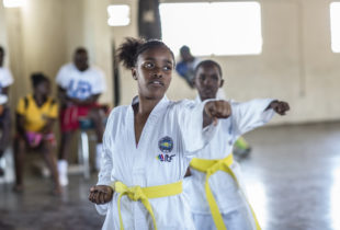 Photograph of Sabrina Spencer and Teshawn Jones participating in Taekwondo training with Fight for Peace in Parade Gardens, Kingston