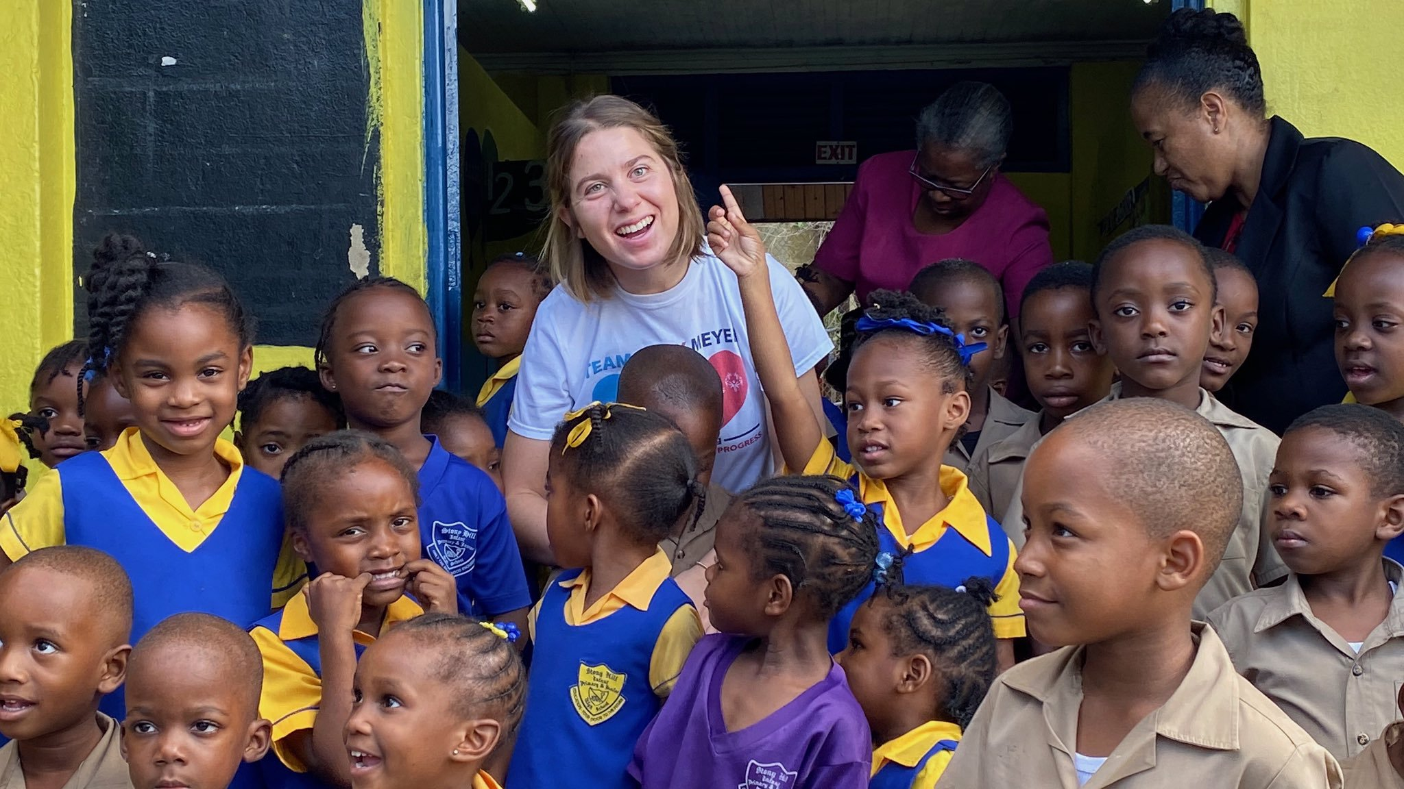 Photograph of Lucy Meyer with students at Stony Hill Infant, Primary and Junior High School