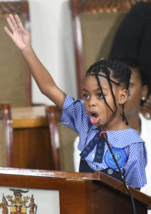 Photograph of Ngozi Wright aged 7, who was among a group of children who became the first in Jamaican history to address a sitting of Parliament, on November 19, 2019, the day before World Children's Day.