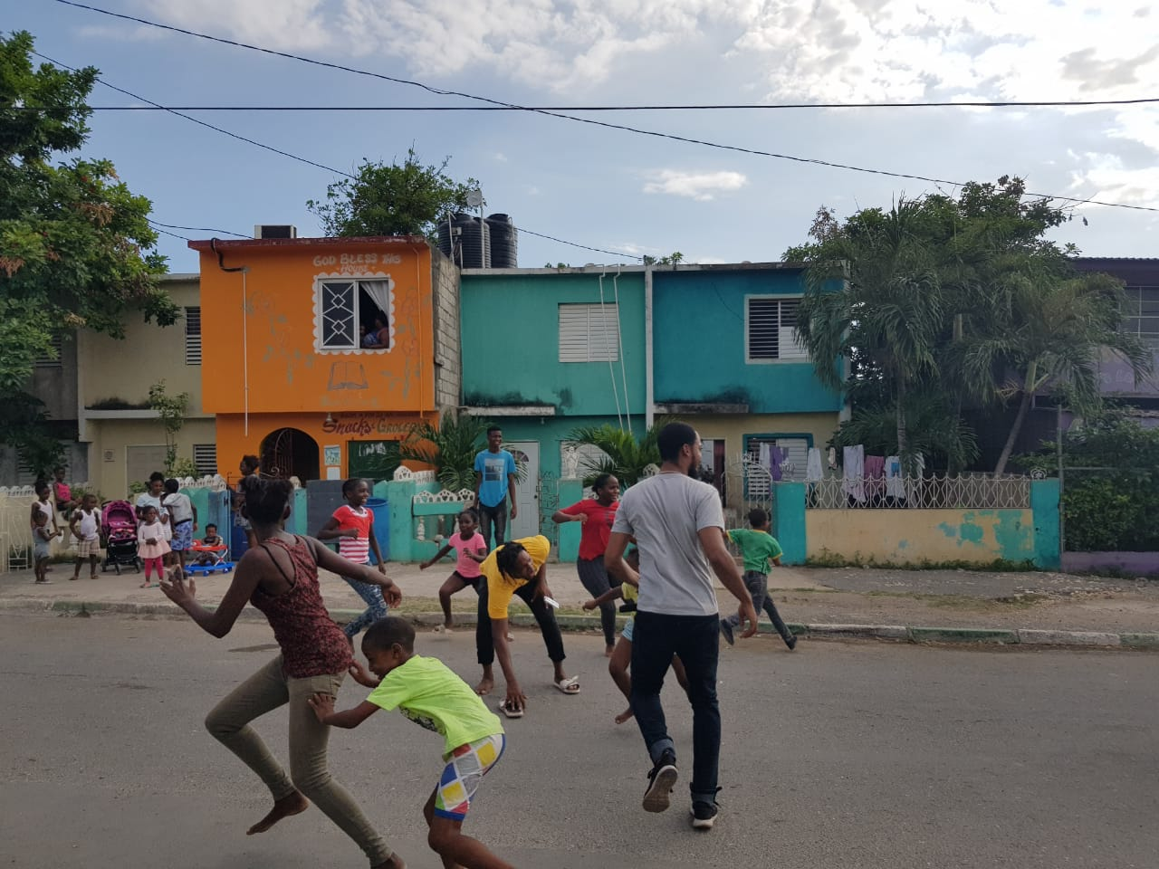 Photograph of a Street Play JA session taking place in downtown Kingston.