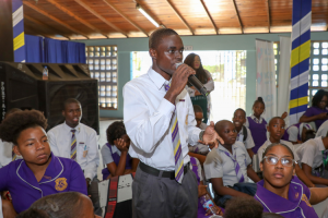 Photograph of a student asking a question at a Safer Internet Day event held by the FLOW Foundation at Merl Grove High School.