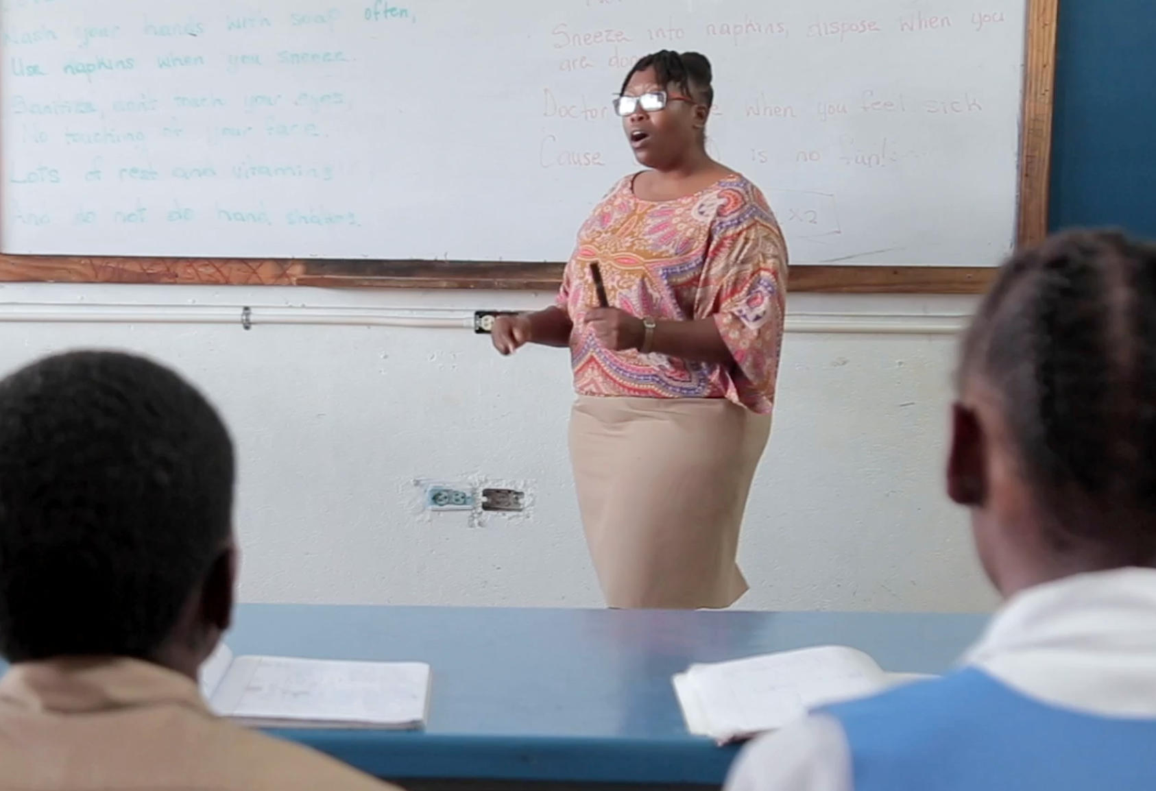 Photograph of Teacher Yanique Dobson with her students at Brown's Town High School in St Ann.