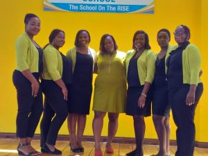 Photograph of Yanique Dobson (far right) together with other members of the Reading Department/ Alternate Pathways to Secondary Education (APSE) team at Brown's Town High School.