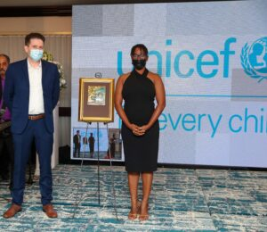 Photograph of Television Jamaica (TVJ) reporter Janella Precius winner of the Press Association of Jamaica 2020 UNICEF Award for Excellence In Reporting On Children's Rights and Ross Sheil, UNICEF Jamaica Communication Officer - Digital Media