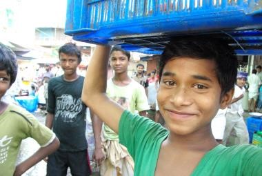 Jibon, 12, works at a fish market in Dhaka to help support his family. Millions of children like Jibon are out of school in South Asia.