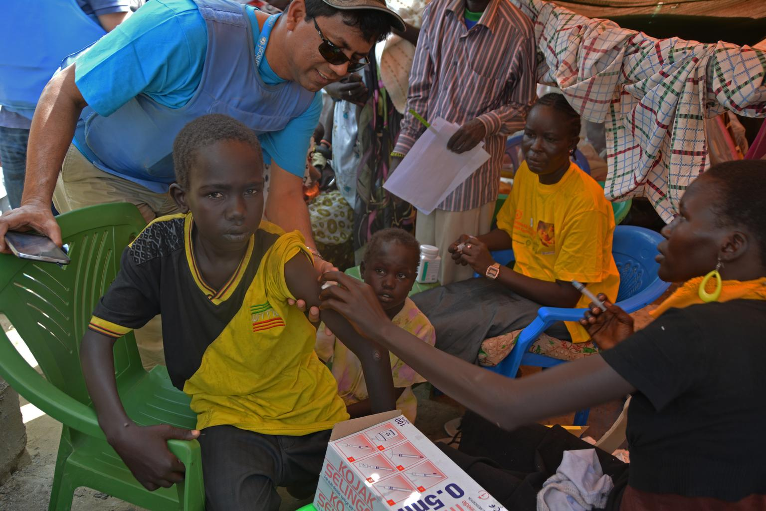 A health worker prepares to vaccinate a boy against measles, outside Bor, the capital of Jonglei State.