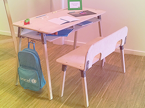 A prototype school desk and bench for two young children.