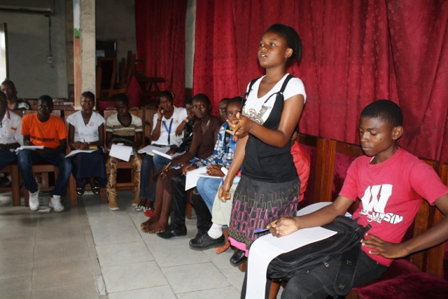 Children listen and reflect on childrens' rights and the importance of peace in their country. DRC, Kinshasa.