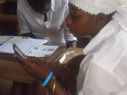 A student in Kalangala District signing up for U-report.