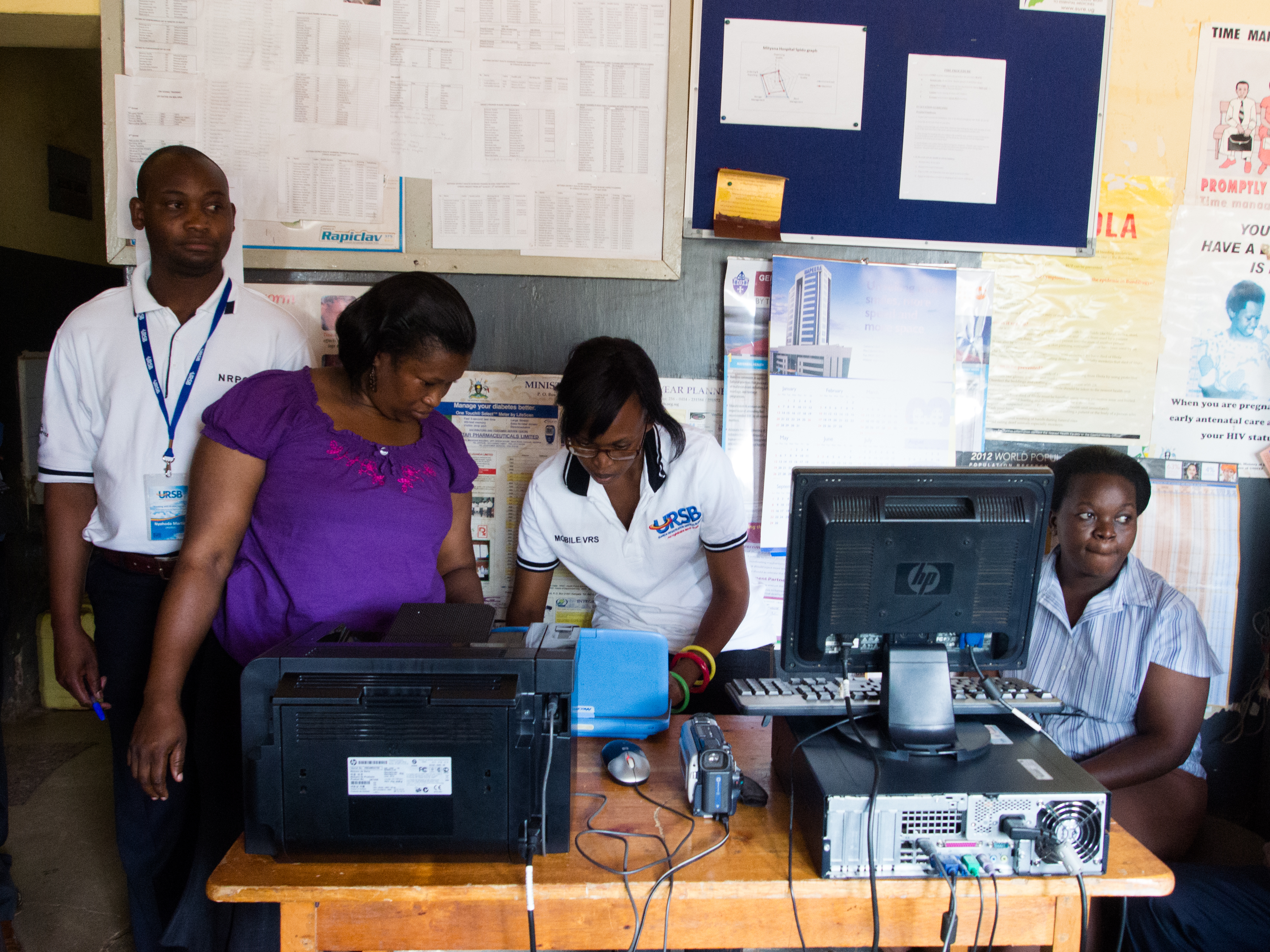Local staff printing a birth certificate at Mityana hospital in Uganda using technology called Mobile Vital Records System.