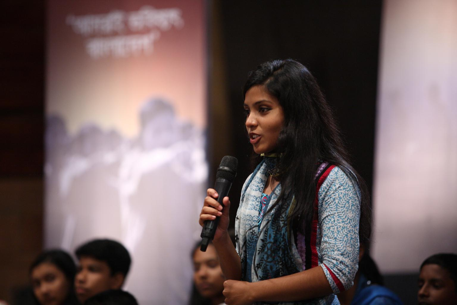 Sanjana, a child participant, asks questions during the Children's Dialogue (Projonmo Sanglap) in Dhaka, Bangladesh, which took place in February.
