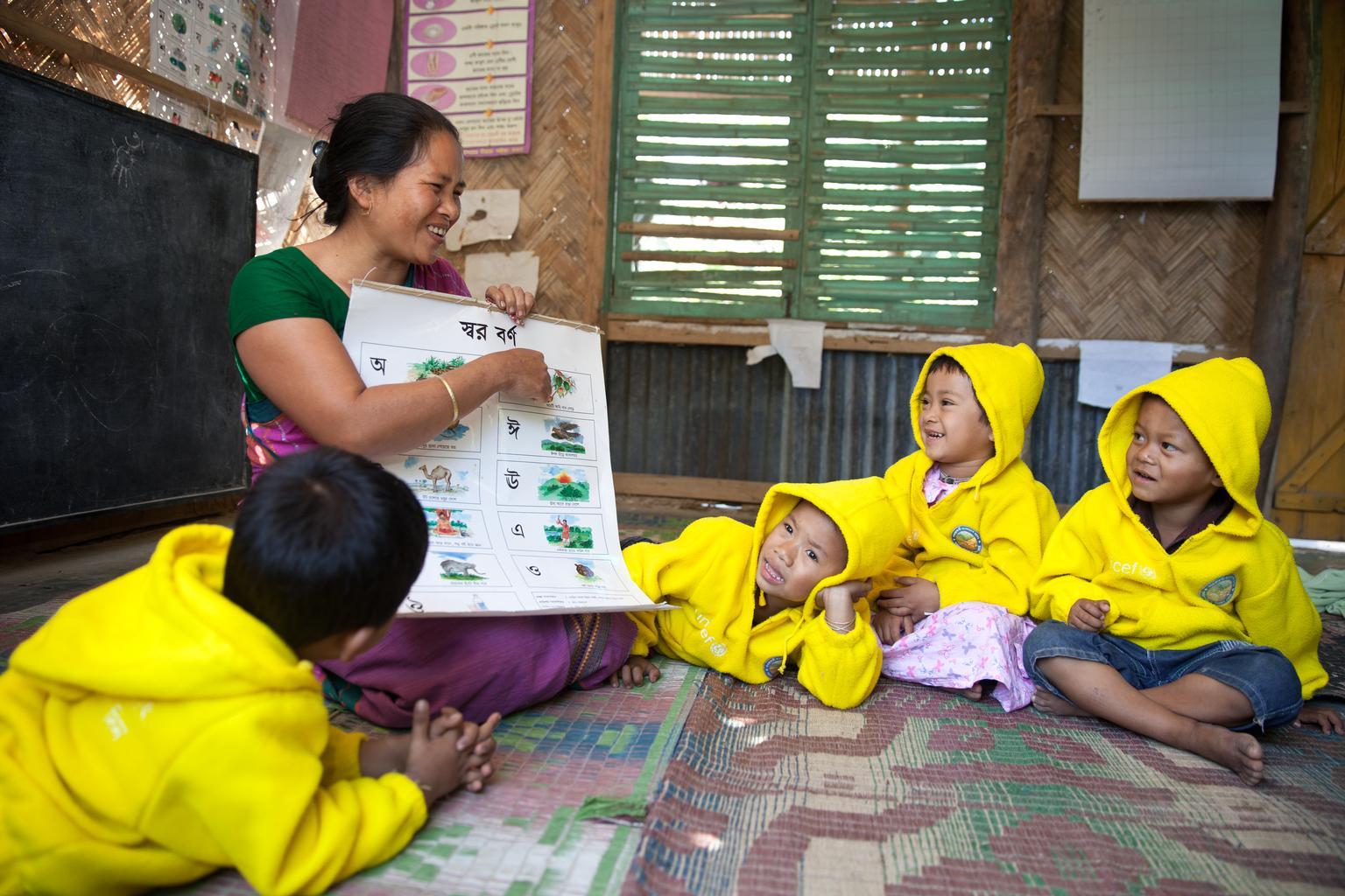 Toddlers in Bangladesh are introduced to the alphabet.