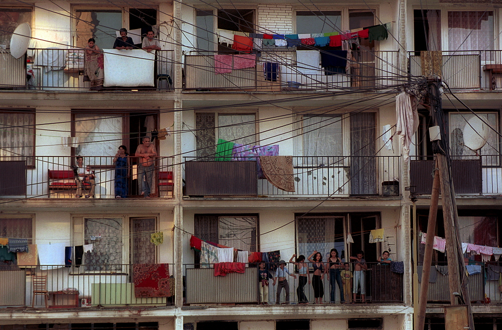 Girls dance on a balcony in Lunik IX, a cluster of run-down buildings on the outskirts of Kosice, Slovakia's second largest city. Once a racially mixed neighbourhood, Lunik IX has become an urban ghetto for around 4500 impoverished Roma people.