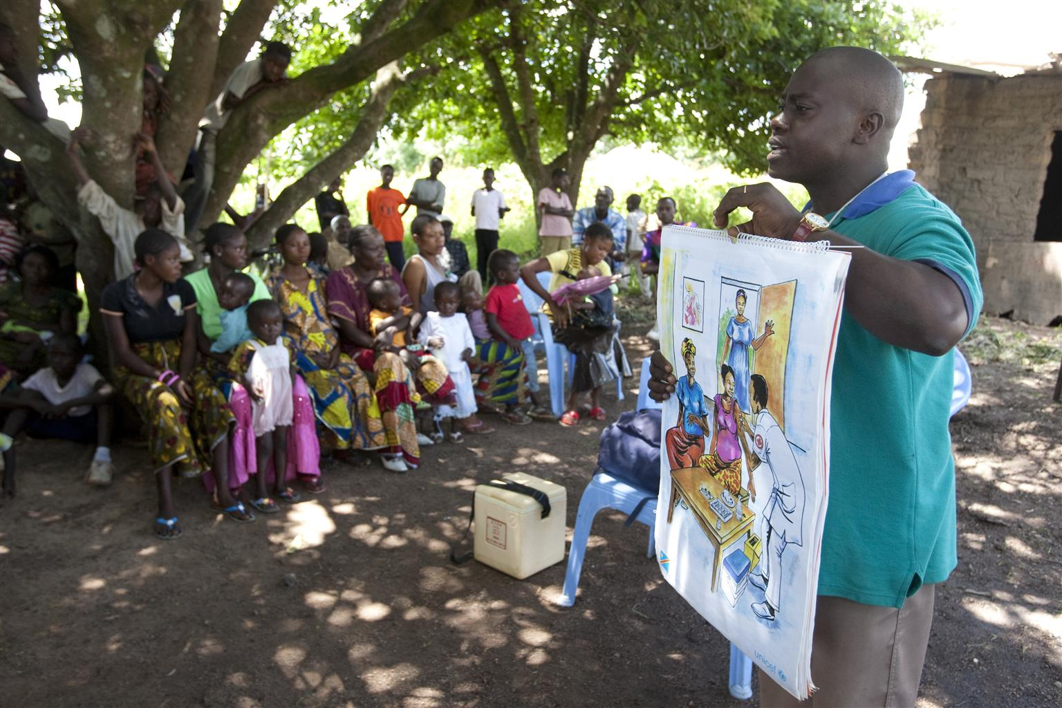 A nurse  delivers a presentation about the importance of tetanus vaccination, before the start of an immunization session in Mukanga-Moke Village, Katanga Province, Democratic Republic of Congo.