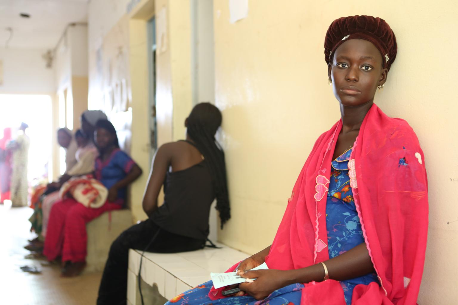 20 year old Fatim from Senegal, pregnant with her third baby, waits to be immunised against Maternal and Neonatal Tetanus.
