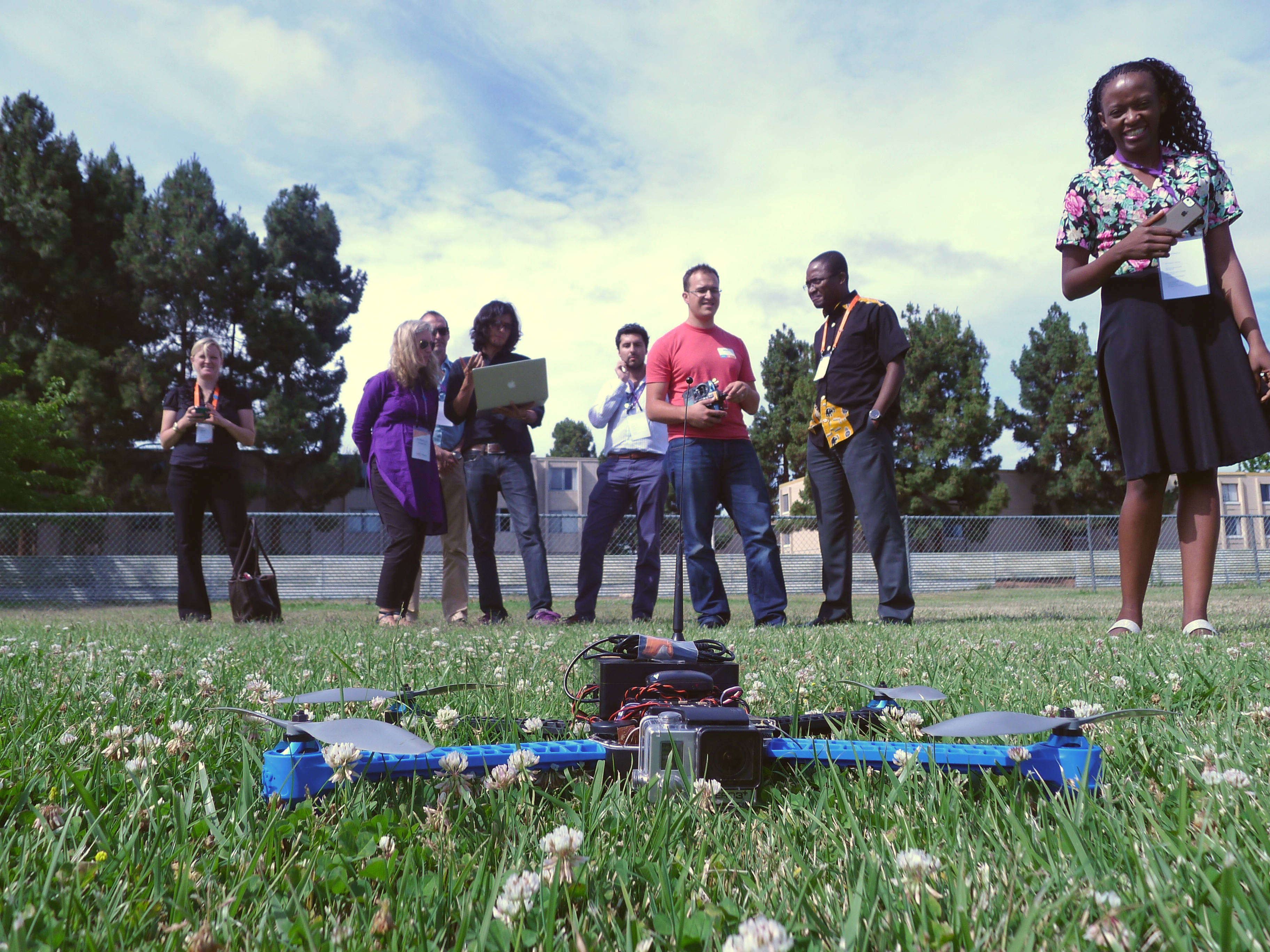 UNICEF staff get a demo of unmanned aerial vehicles on the ball field at Singularity University.