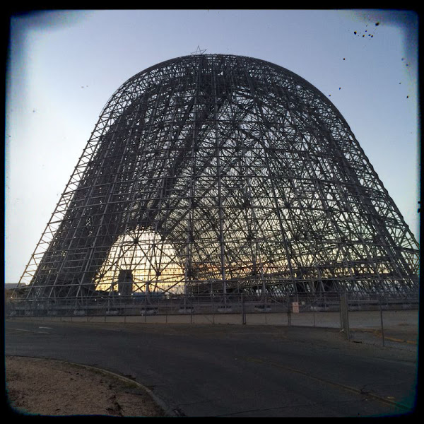 The university shares space on Moffett Field, a joint civil-military airbase, with NASA. This image is Hangar 1, one of the old, decommissioned hangars where the US Navy once stored its blimps. It's one of the largest freestanding buildings in the world. And Google just bought it for robotics research. (c) UNICEF 2014/Fabian